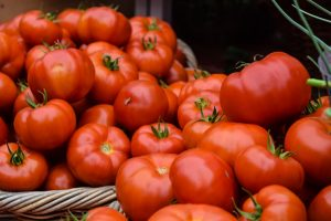 Picture of many red tomatoes in a basket