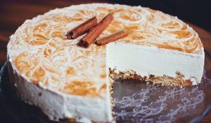 Cinnamon cheesecake with a slice eaten