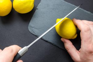 Cutting citrus fruit with a knife