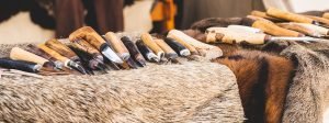 Many knives laid out on a fur