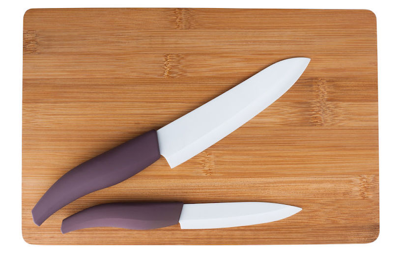 Two ceramic knife with a purple pen on cutting boardCeramic knives