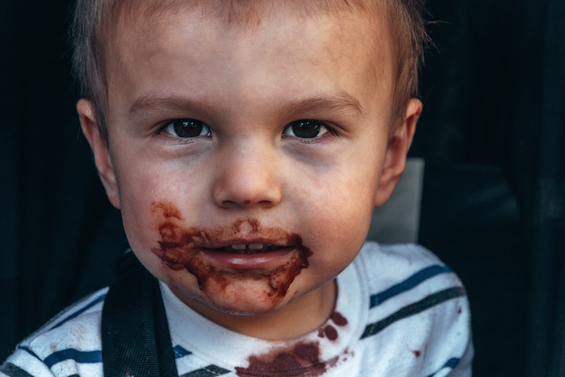 Toddler with chocolate on face