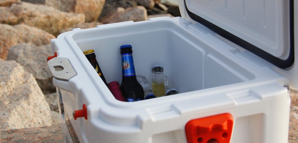 Beer in a cooler half full at beach