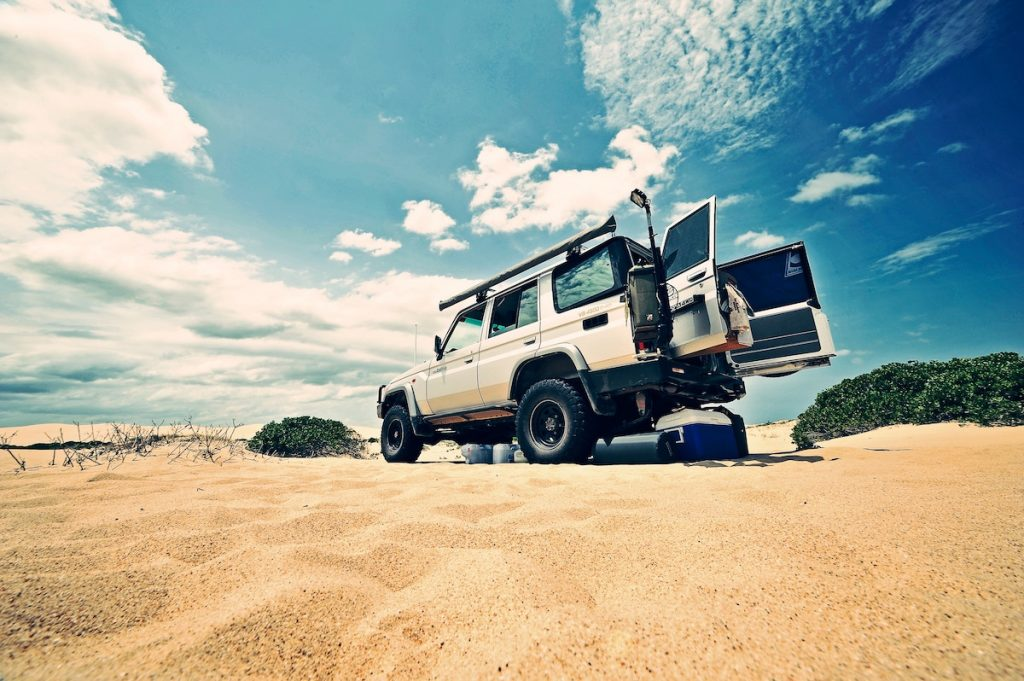 Cooler in back of SUV in a desert for camping