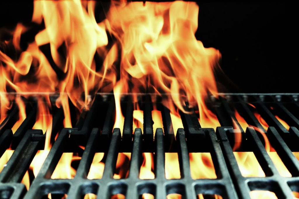 Cast iron grill with fire