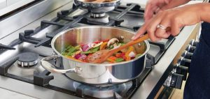 Cooking veggies on a stovetop with gas