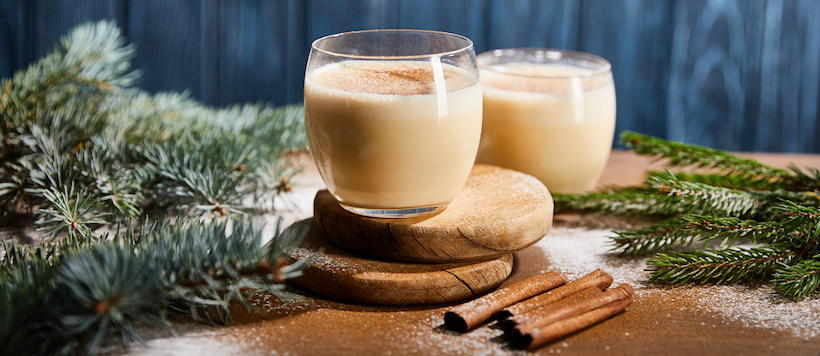 2 cups of eggnog with Holiday garland