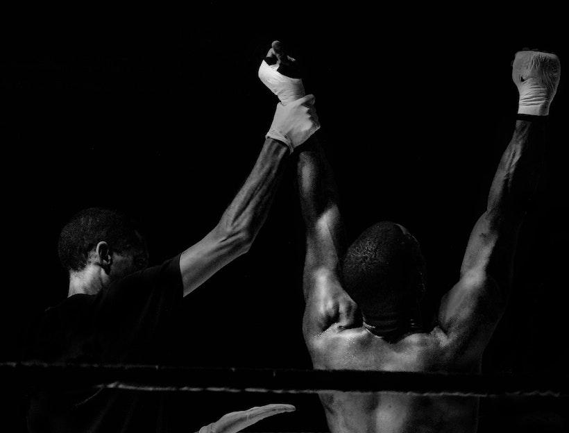 Ref raises a fight winner's hands