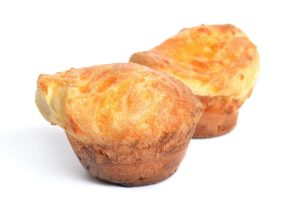 Two Fresh popovers isolated on white background.