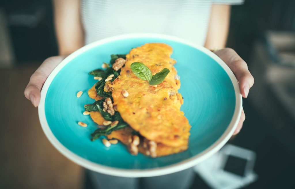 Omelete with mint on a blue plate