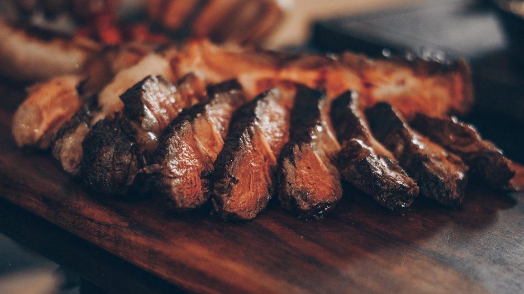Sliced steak on a cutting baord