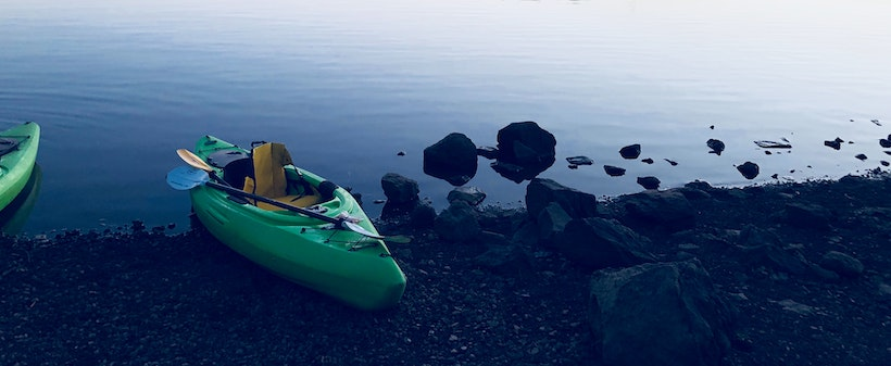 Kayak on a lake shore
