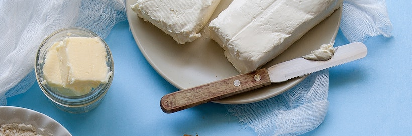 Blocks and sliced butter with a butter knife
