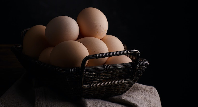 Eggs in.a basket on a table