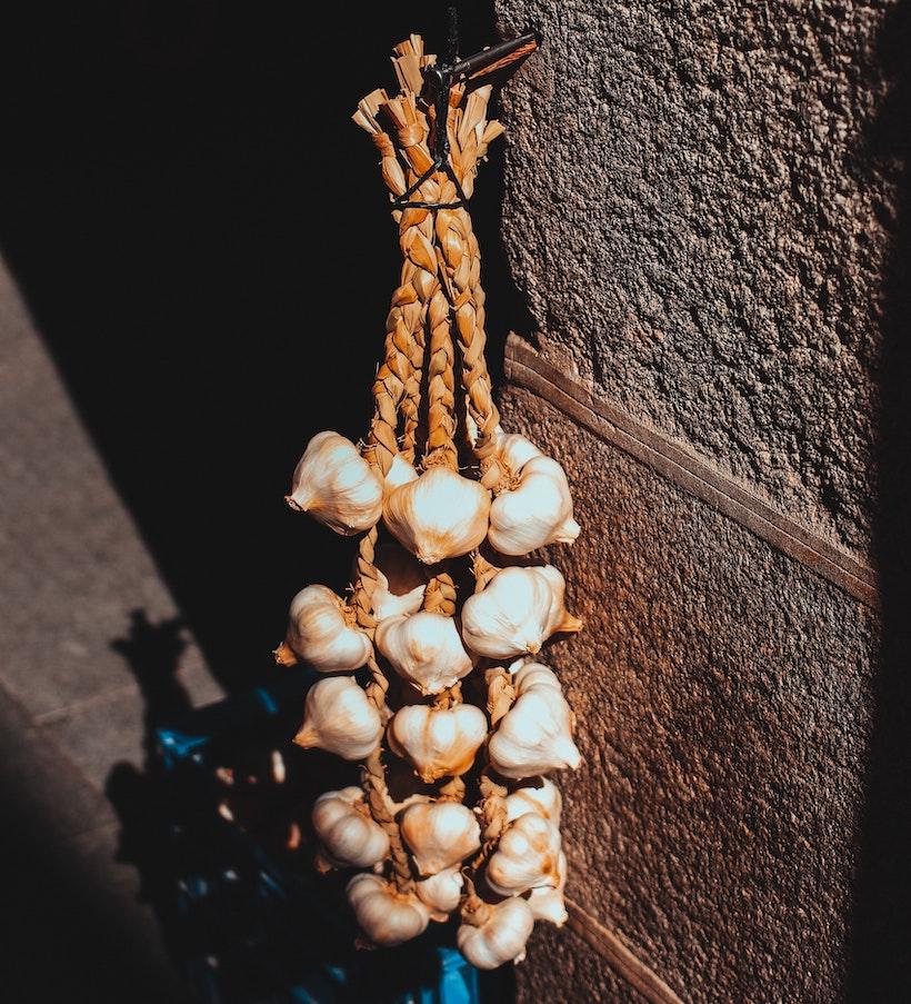 Garlic hanging on a wall