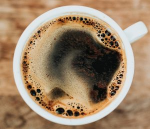 Aerial view of a freshly brewed coffee cup