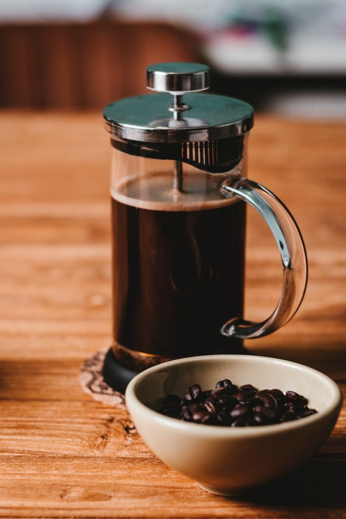 French press coffee next to beans