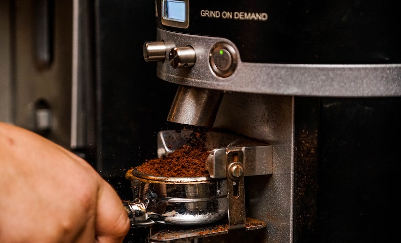 Grind on Demand Machine with coffee grounds
