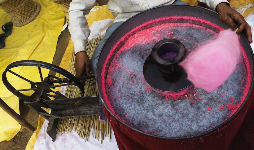 Vendor making pink cotton candy on his machine