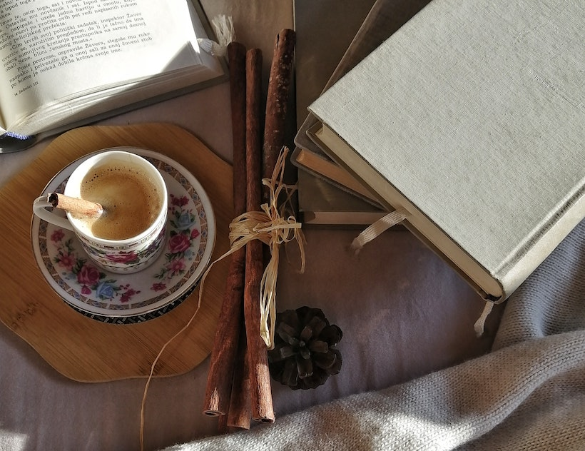 Chai tea next to some books