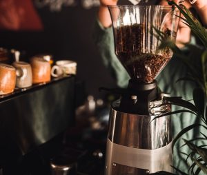 Pouring beans into a coffee grinder